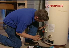 Sunnyvale water heater repair specialist checks the electrical panel